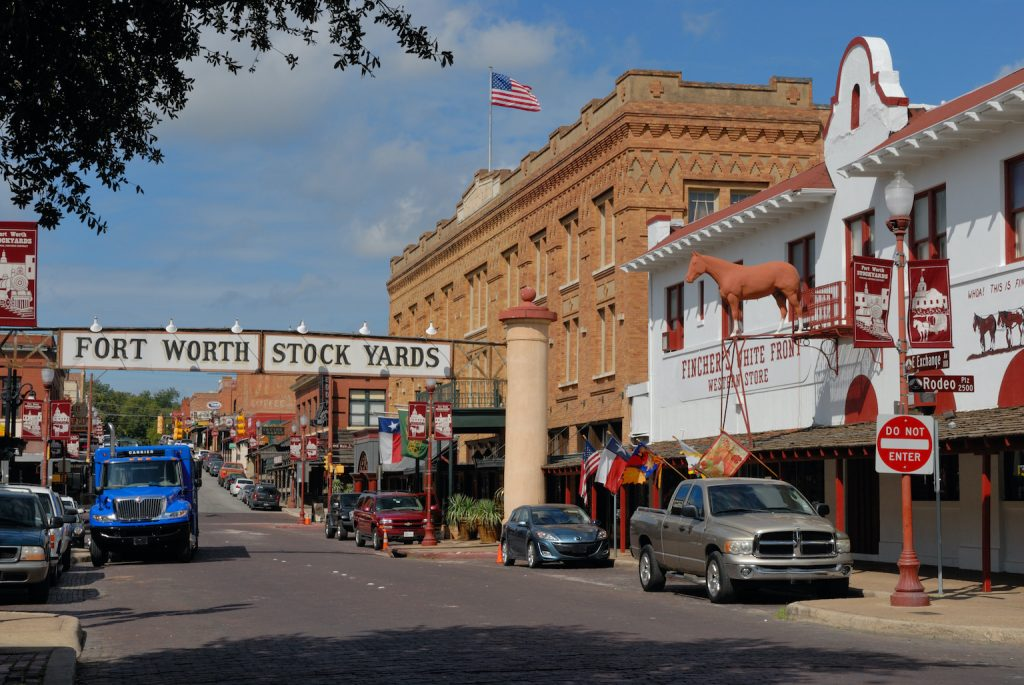 Exchange Avenue, The Stockyards Hotel, and Fincher's White Front Western Store in the Fort Worth Stockyards Historic Distric. NRHP Ref 76002067.